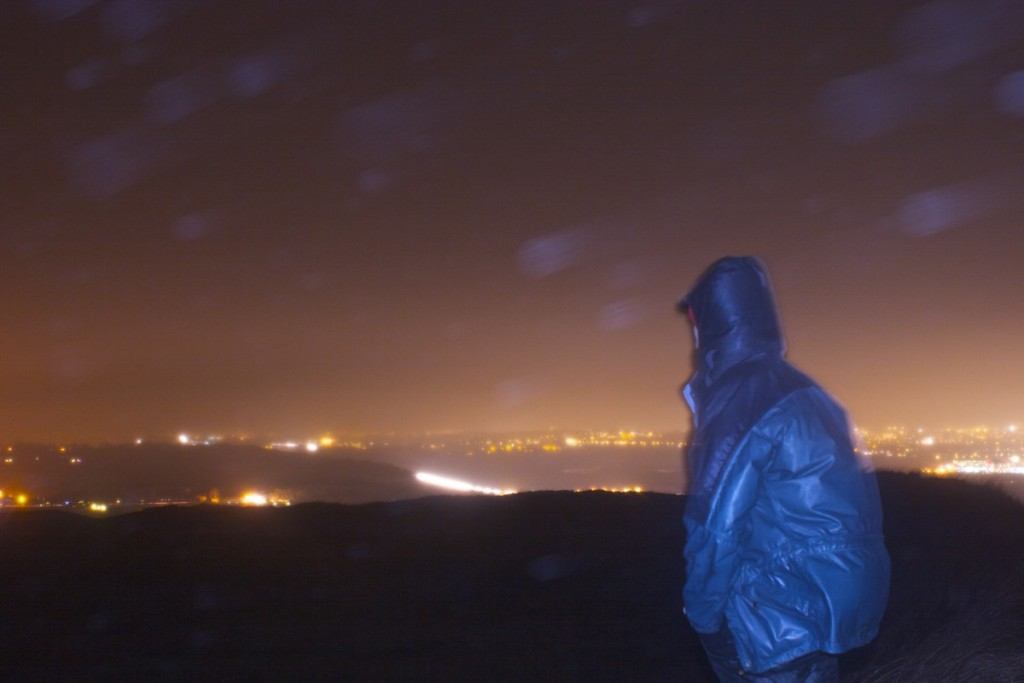 Looking out over the twinkling lights of Swindon from Liddington Castle